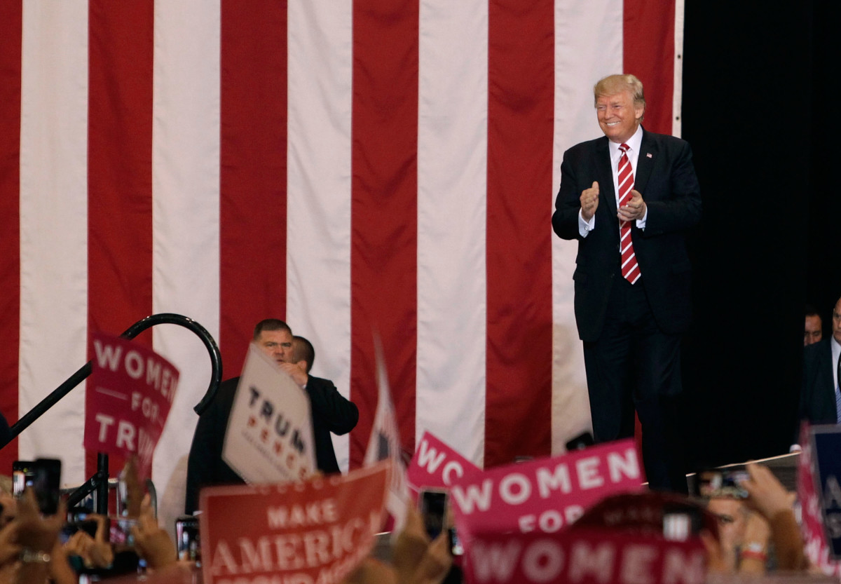 President Donald Trump applauds the crowd of supporters at the Phoenix Convention Center as he takes the stage during a rally on August 22nd, 2017, in Phoenix, Arizona.