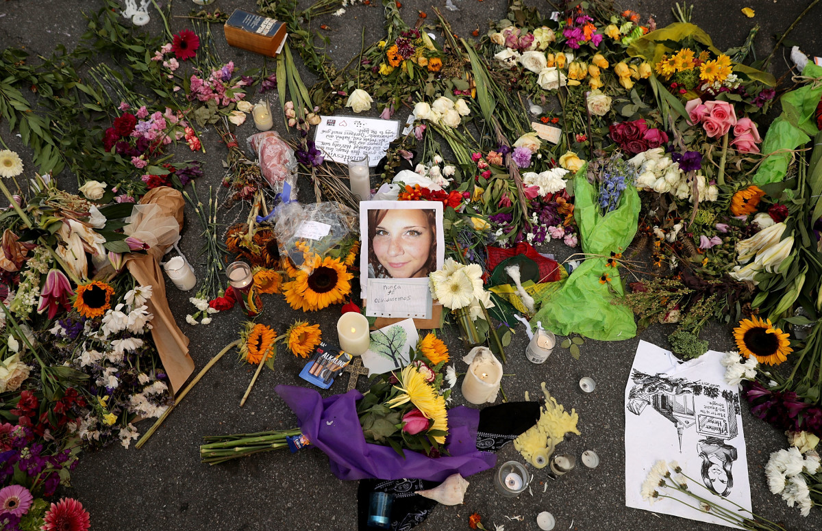 Flowers, candles, and chalk-written messages surround a photograph of Heather Heyer on the spot where she was killed and 19 others injured when a car slammed into a crowd of people protesting against a white supremacist rally on August 16th, 2017, in Charlottesville, Virginia.
