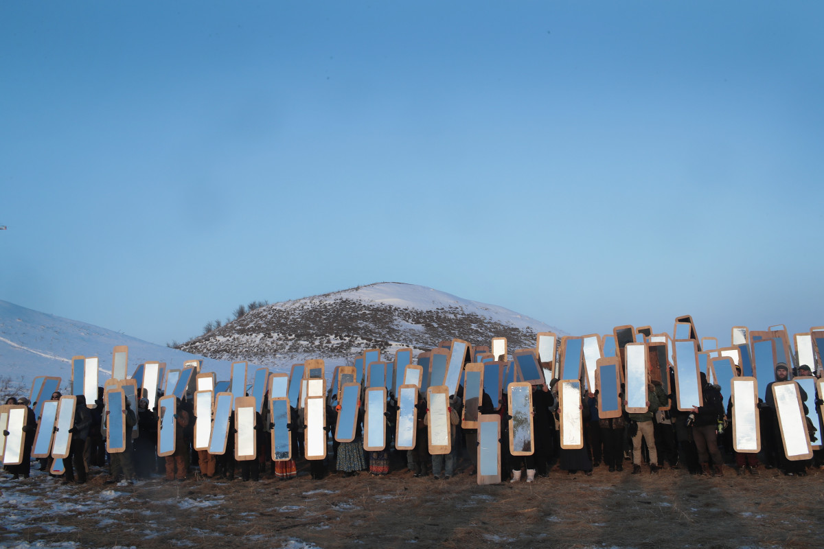 Activists participate in an art project conceived by Cannupa Hunska Luger, from the Standing Rock Sioux Tribe, at Oceti Sakowin Camp on the edge of the Standing Rock Sioux Reservation on December 3rd, 2016, outside Cannon Ball, North Dakota.