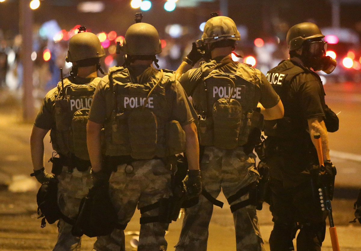Police advance on demonstrators protesting on August 17th, 2014, in Ferguson, Missouri.