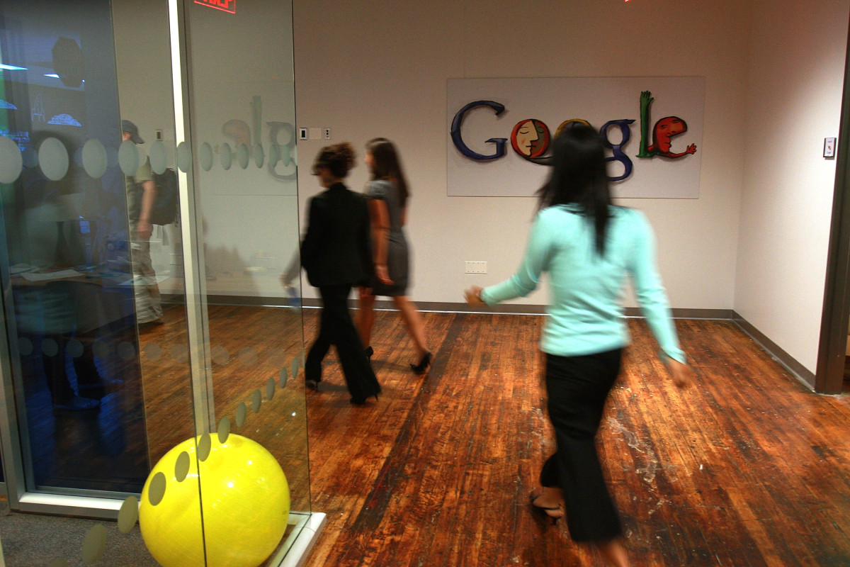 Employees of Google walk down a hallway at the New York office in 2008.