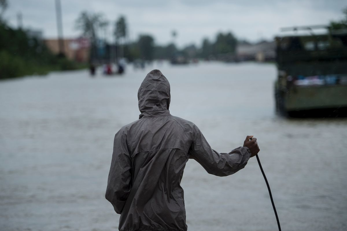 A man looks out on a flooded road during the aftermath of Hurricane Harvey on August 29th, 2017, in Houston, Texas.
