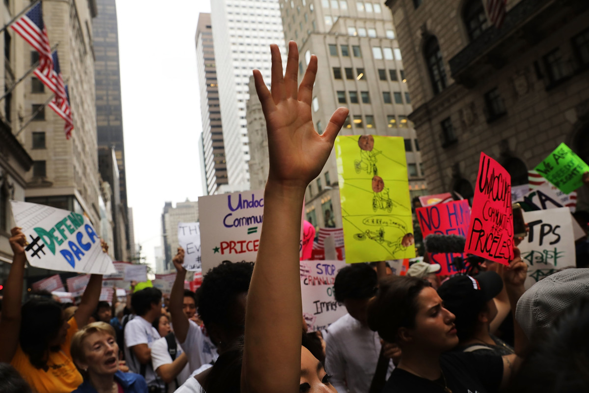 Dozens of immigration advocates attend a rally outside of Trump Tower on August 15th, 2017, in New York City.