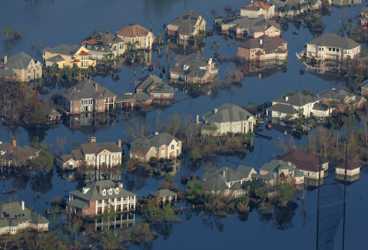 An aerial image of neighborhoods flooded with oil and water two weeks after Hurricane Katrina went though Louisiana on September 12th, 2005, in New Orleans, Louisiana.