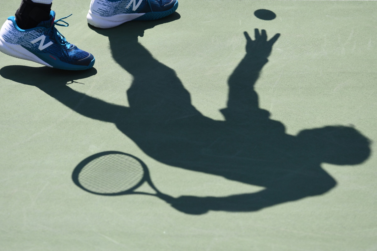 The shadow of France's Jeremy Chardy is seen against France's Gael Monfils during their Qualifying Men's Singles match at the 2017 U.S. Open Tennis Tournament on August 29th, 2017, in New York.
