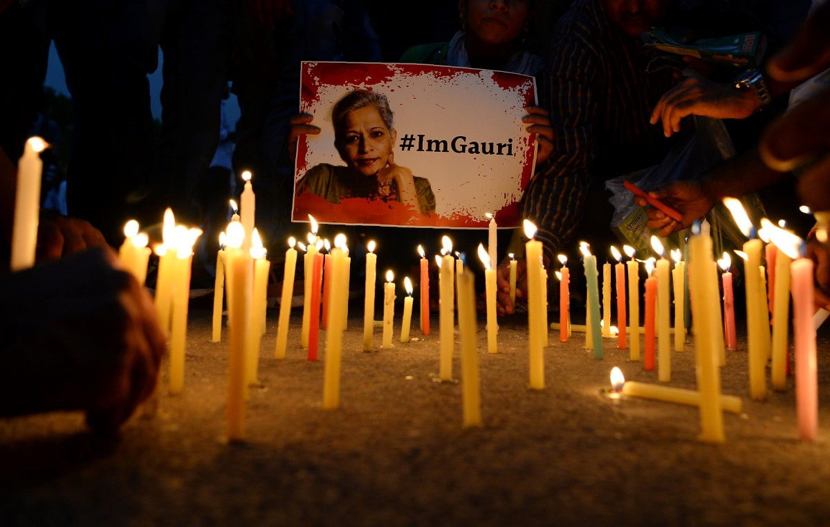 Indian activists take part in a protest rally against the killing of Indian journalist Gauri Lankesh at the India Gate memorial in New Delhi on September 6th, 2017. Indian activists, politicians, and journalists demanded a full investigation into the murder of Gauri Lankesh, a newspaper editor and outspoken critic of the ruling Hindu nationalist party whose death has sent shockwaves across the country.