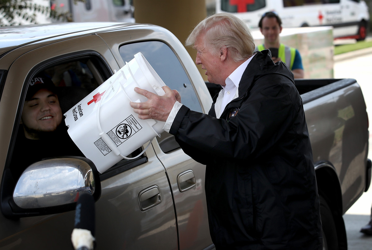 President Donald Trump attempts to help move emergency supplies during Hurricane Harvey in Pearland, Texas, on September 2nd, 2017.