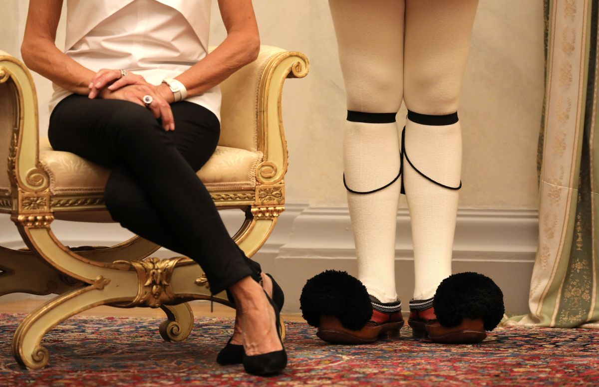 The shoes of French president's wife Brigitte Macron (left) are pictured next to the Greek guard's shoes during a welcoming ceremony at the presidential palace in Athens, on September 7th, 2017, as part of a two-day official visit of the French president to Greece.