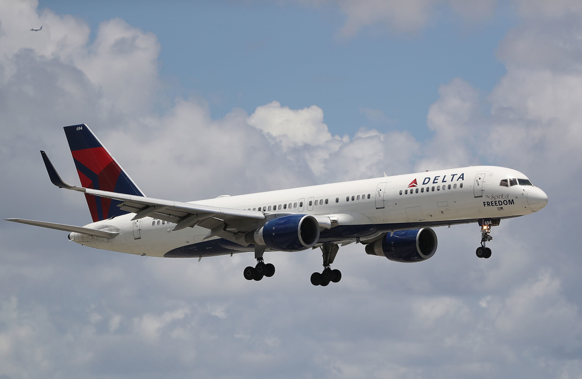A Delta airlines plane is seen as it comes in for a landing at the Fort Lauderdale-Hollywood International Airport in Fort Lauderdale, Florida.