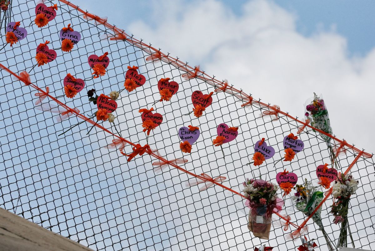 Memorials are seen on a fence surrounding Marjory Stoneman Douglas High School in Parkland, Florida, on February 21st, 2018.