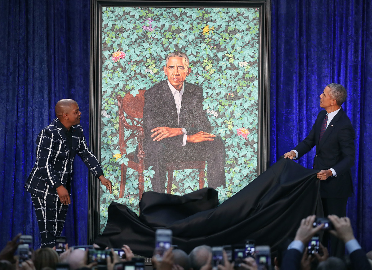 Former U.S. President Barack Obama and artist Kehinde Wiley unveil Obama's portrait during a ceremony at the Smithsonian's National Portrait Gallery on February 12th, 2018, in Washington, D.C.