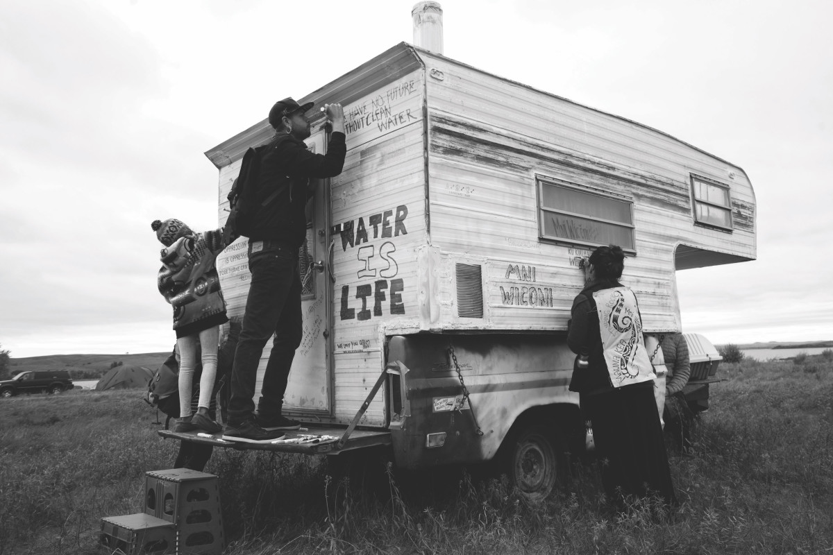 Decorating artist and activist Billy McMaster's trailer at Sacred Stone Village.