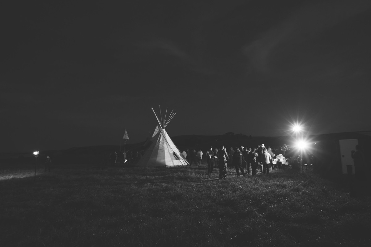 An evening gathering at Sacred Stone Village.
