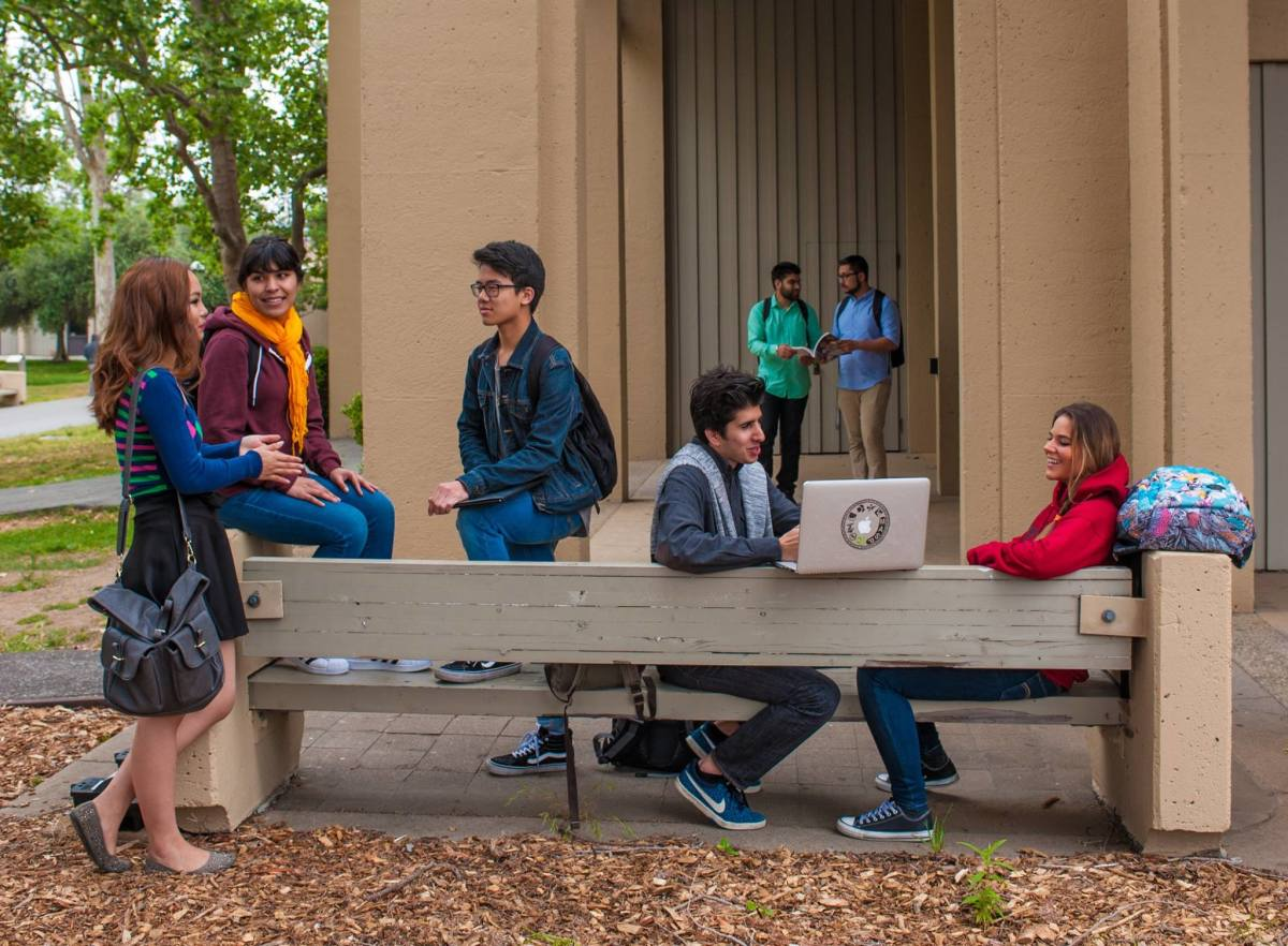 Students hang out on campus at De Anza College in Cupertino, California.