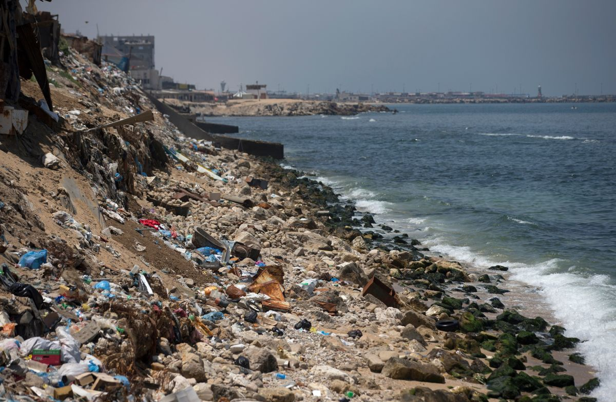 A general view taken on July 2nd, 2017, shows rubbish strewn along the coastline in Gaza City.