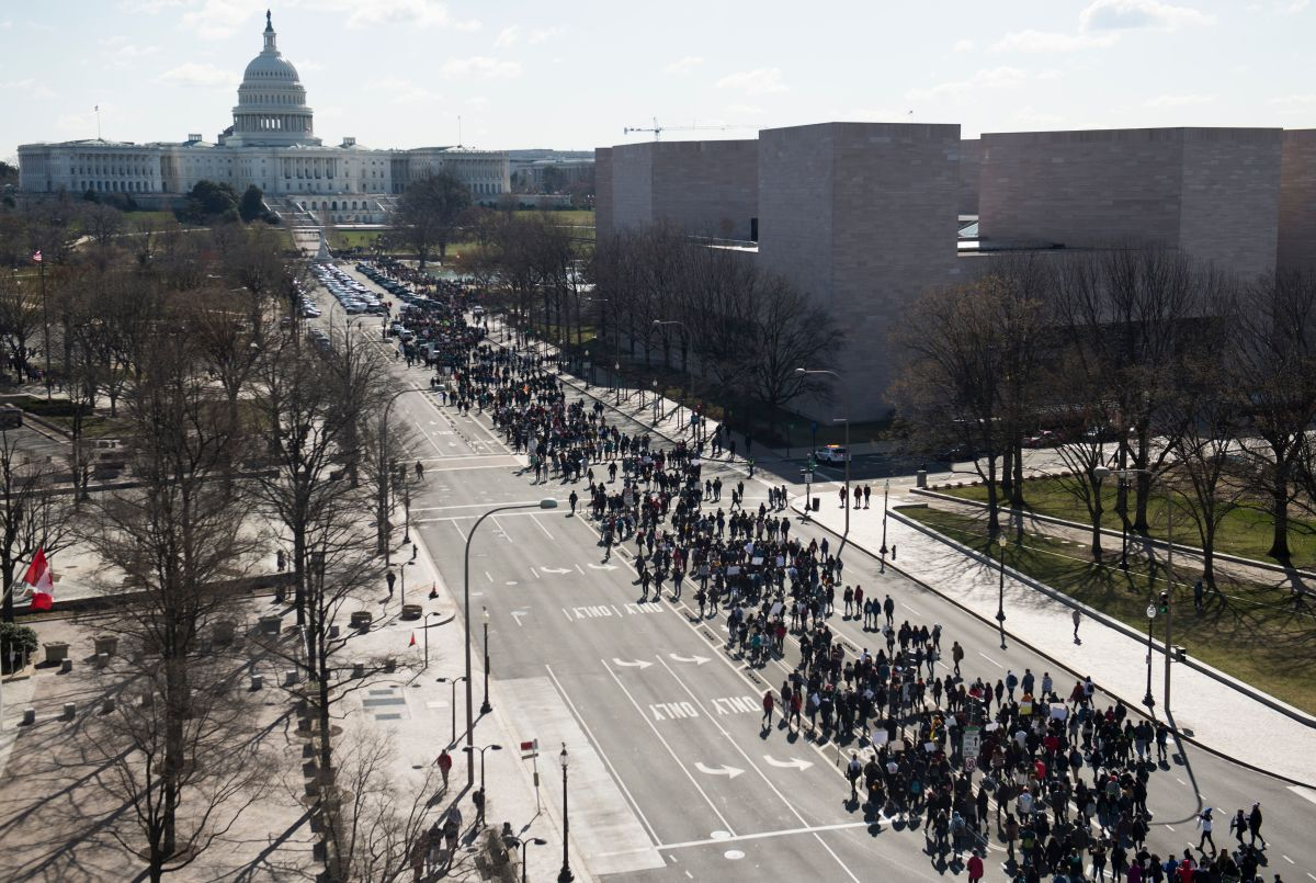 Thousands of local students march down Pennsylvania Avenue during the walkout in Washington, D.C.
