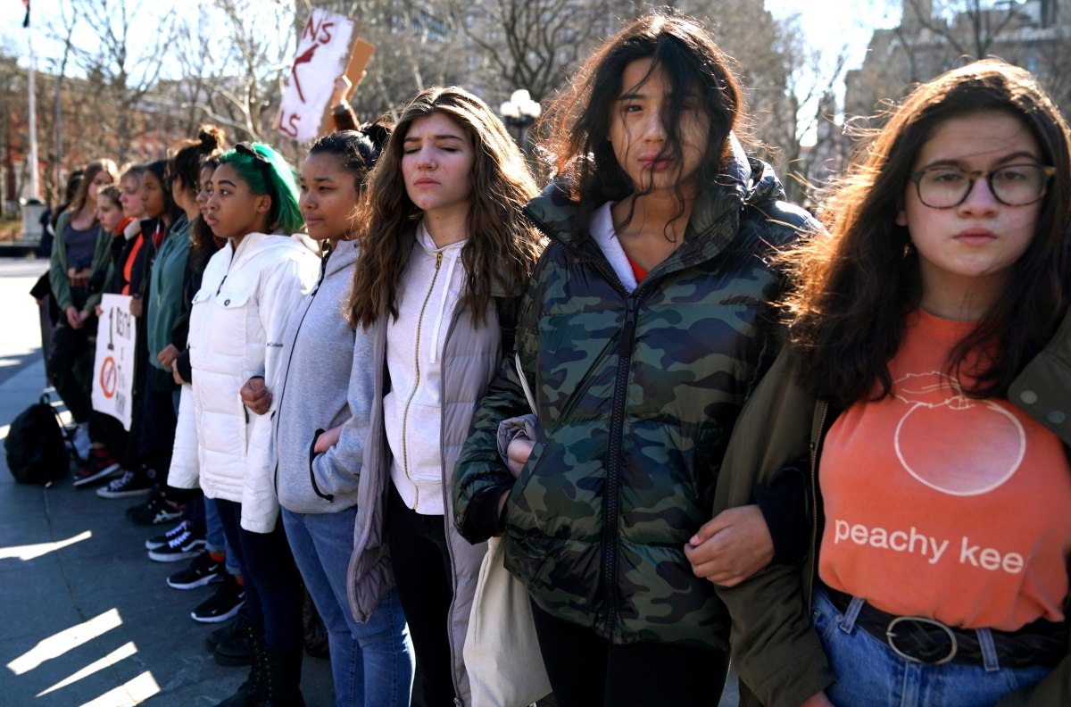 Students from Harvest Collegiate High School in New York City, New York, form a circle around the fountain in Washington Square Park to take part in a national walkout to protest gun violence.