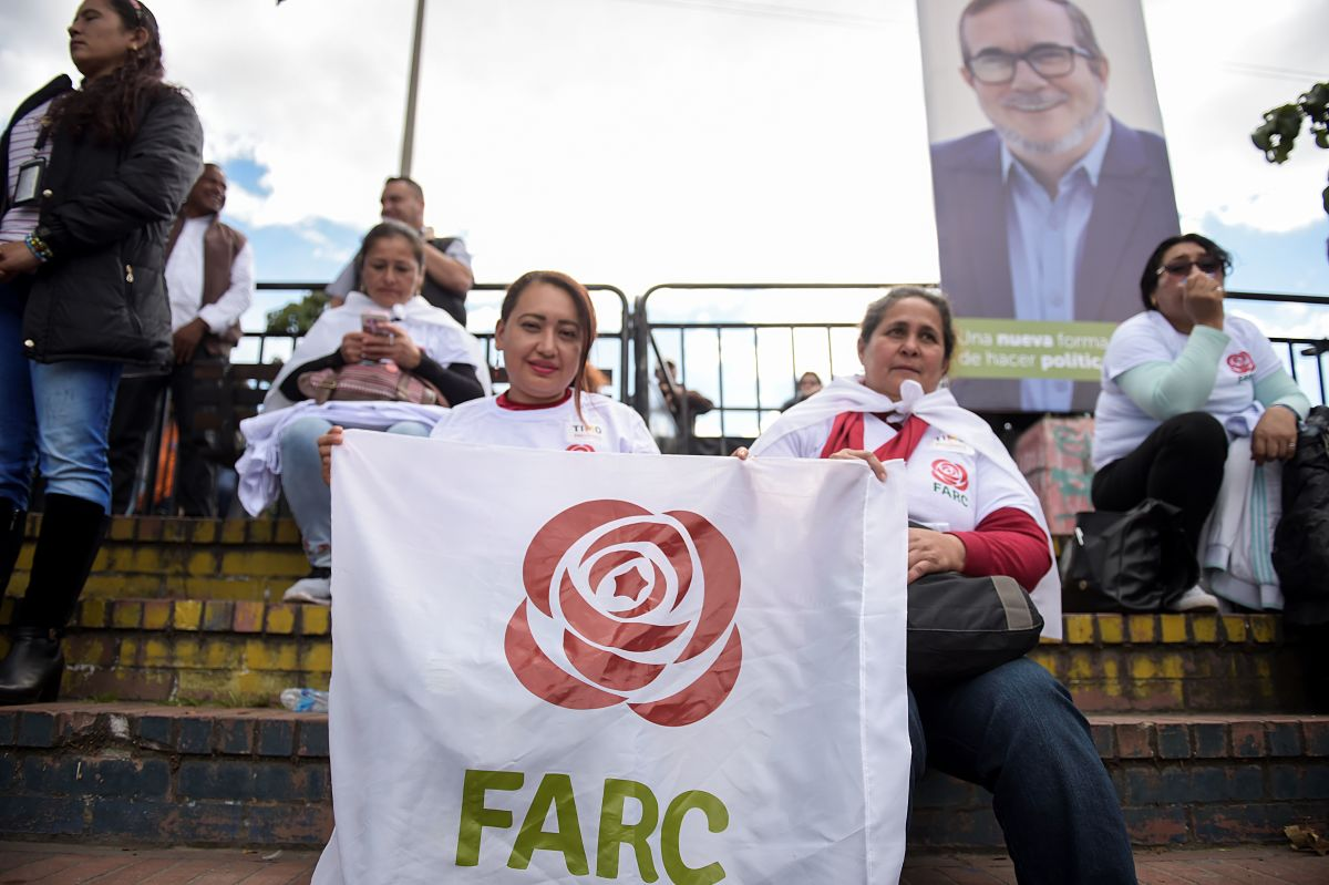 "Women hold a banner with the logo of the FARC political party during the launch of the political campaign for president of FARC leader Rodrigo Londono Echeverri, known as ""Timochenko."""