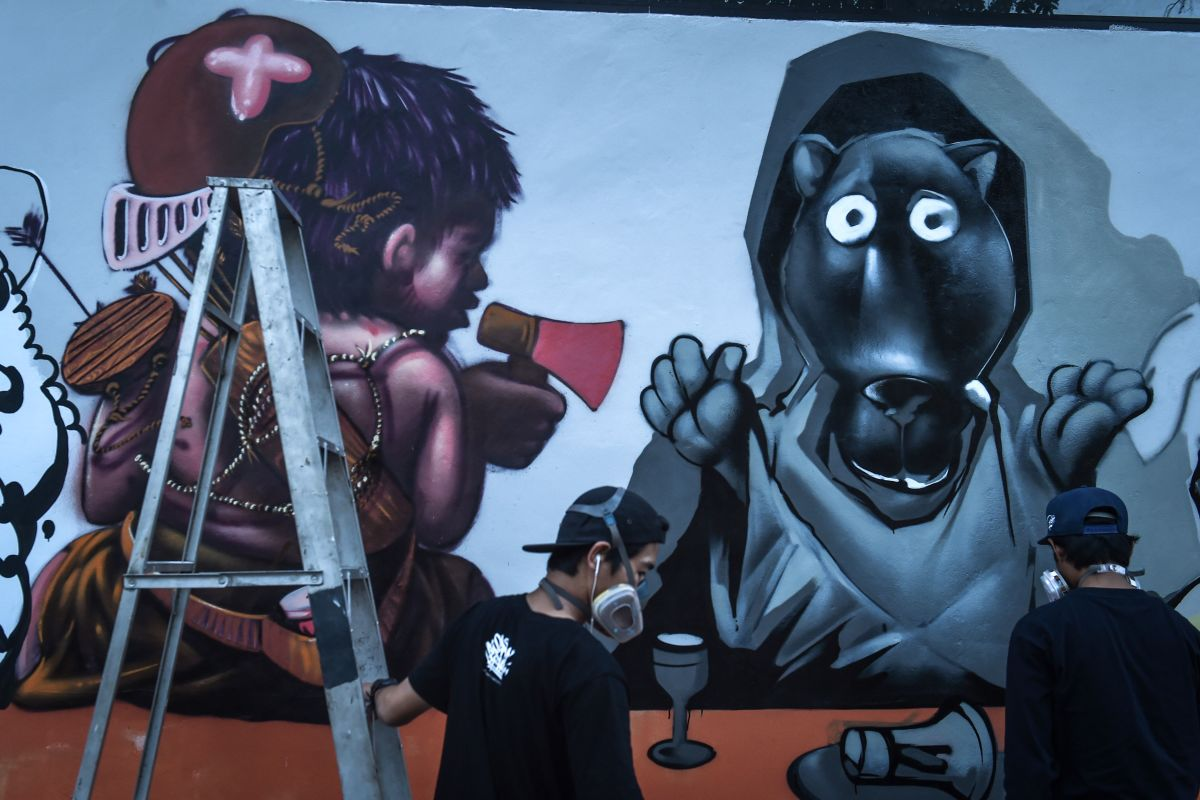 Graffiti artists depict construction tycoon Premchai Karnasuta (left) next to a black panther in Bangkok, Thailand, on March 16th, 2018. This is the latest subversive depiction of an animal that has come to symbolize wild cat-poaching injustice.