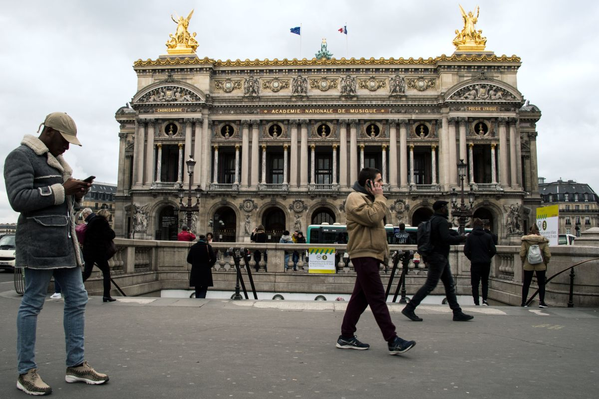 People walk in front of the Garnier Opera House in Paris, France, on March 21st, 2018.