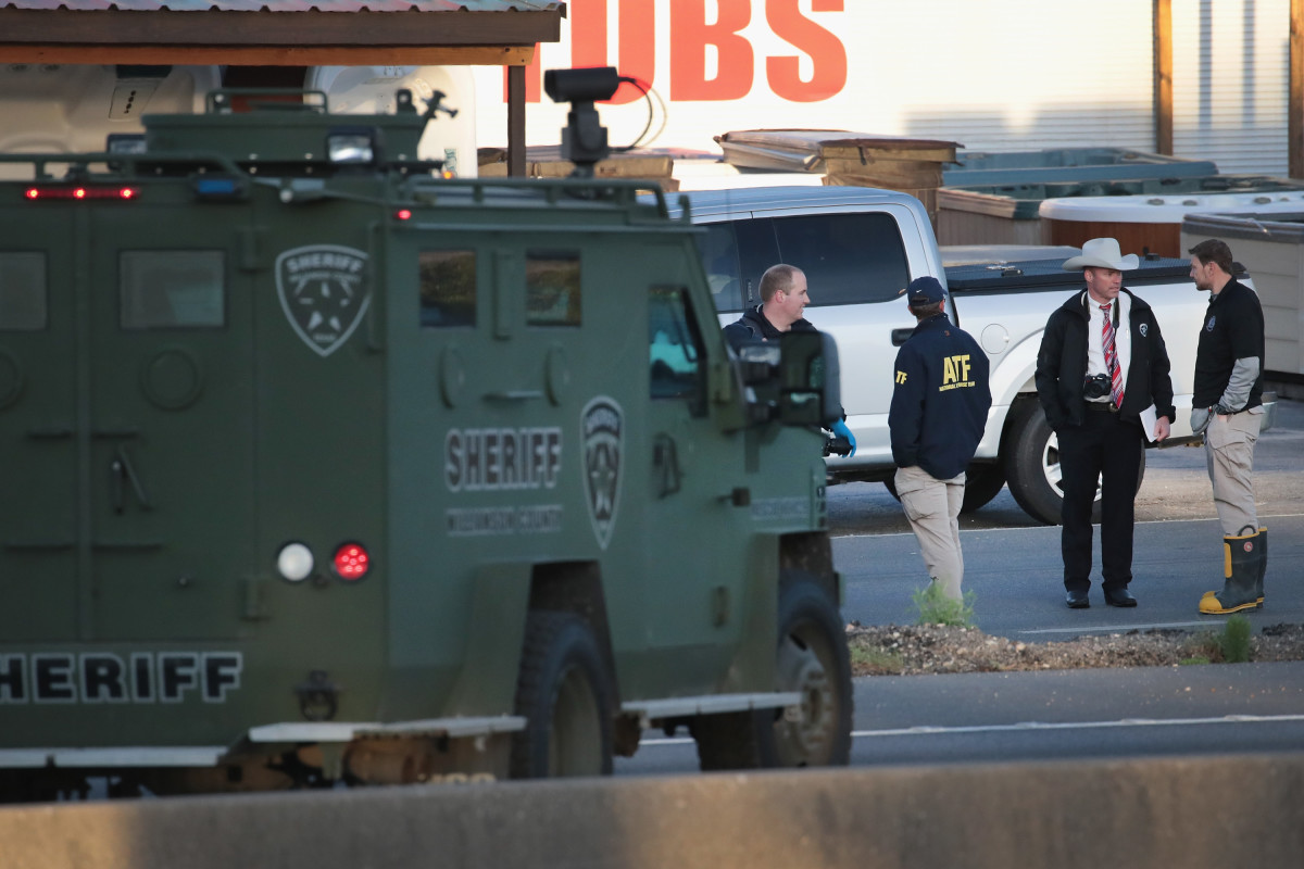 Law enforcement officials search for evidence after Mark Anthony Conditt, the suspected package bomber, blew himself up inside his vehicle as police approached to take him into custody in Round Rock, Texas, on March 21st, 2018.