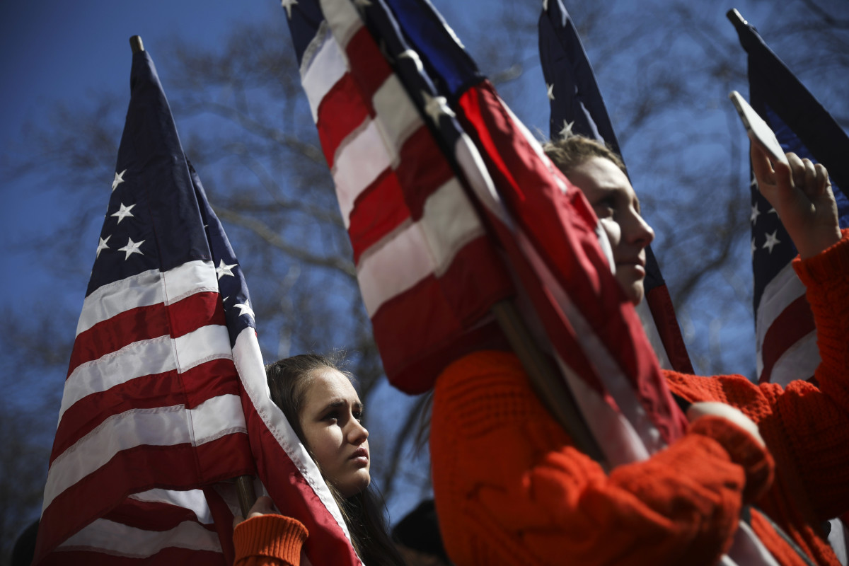 High school students from New Jersey hold American flags as they attend the March For Our Lives rally just north of Columbus Circle in New York City. Thousands of demonstrators, including students, teachers, and parents are gathering in Washington, New York City, and other cities across the country for an anti-gun violence rally organized by survivors of the Marjory Stoneman Douglas High School school shooting.