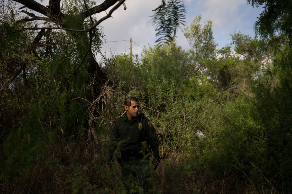Border Patrol agent Robert Rodriguez tracks for signs of undocumented immigrants along the U.S.-Mexico border near McAllen, Texas, on March 26th, 2018.