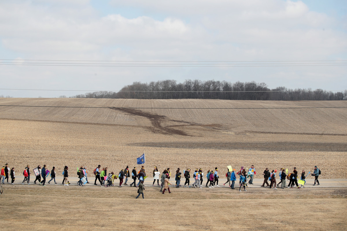 Students march the last leg of a 50-mile journey into the hometown of House Speaker Paul Ryan (R-WI) to call attention to gun violence on March 28th, 2018, in Janesville, Wisconsin. About 40 students from around Wisconsin organized the march, dubbed 50 Miles More, to keep alive the spirit and dialog of the recent March for Our Lives events.