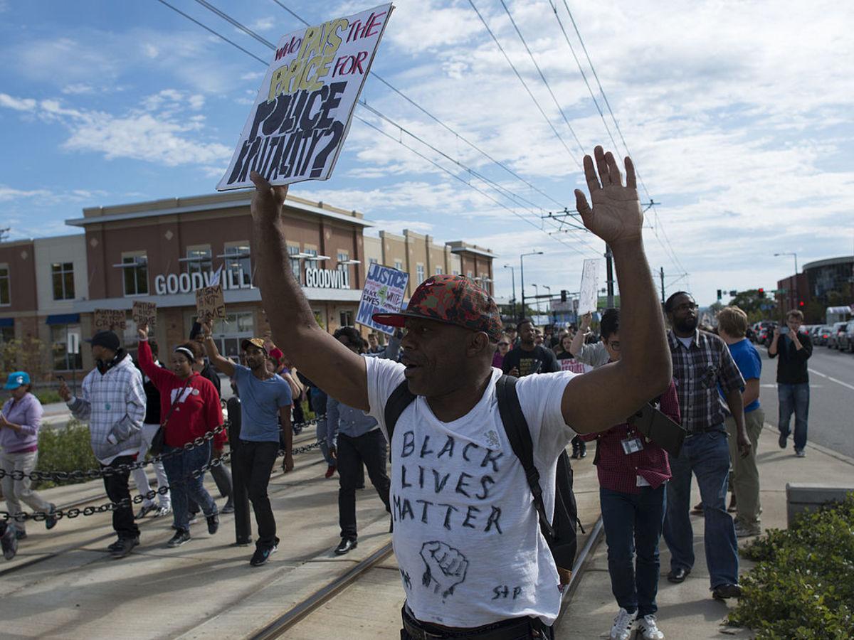 Black Lives Matter protesters demonstrate against police brutality in St. Paul, Minnesota.