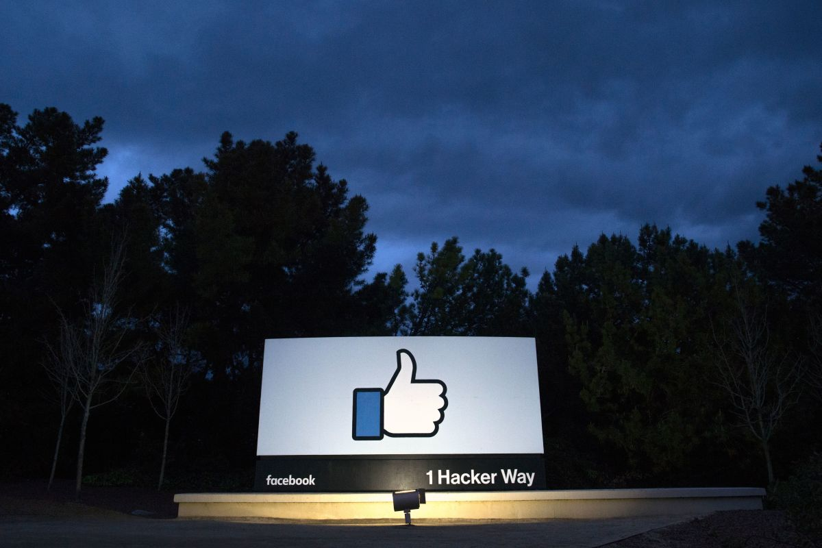 A lit sign at the entrance to Facebook's corporate headquarters in Menlo Park, California.