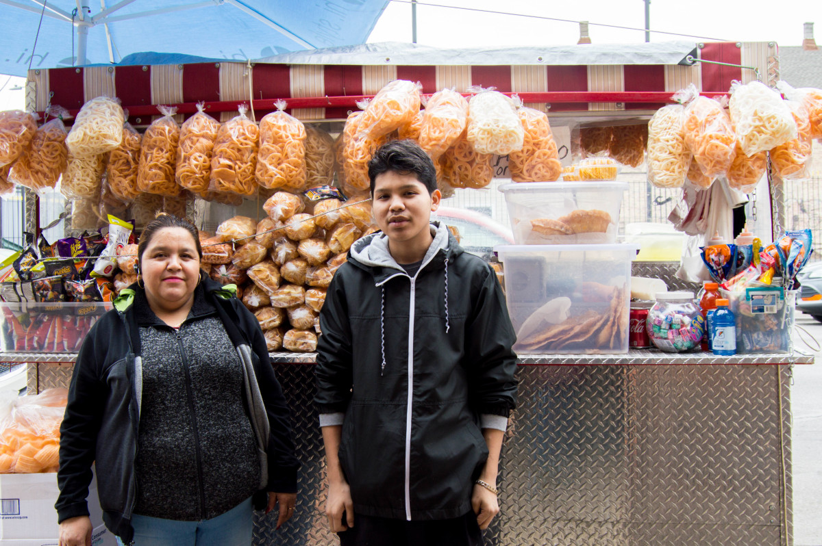 Sonia Ruiz and Jerry Rodriguez run a food cart on 26th Street in Little Village, Chicago.