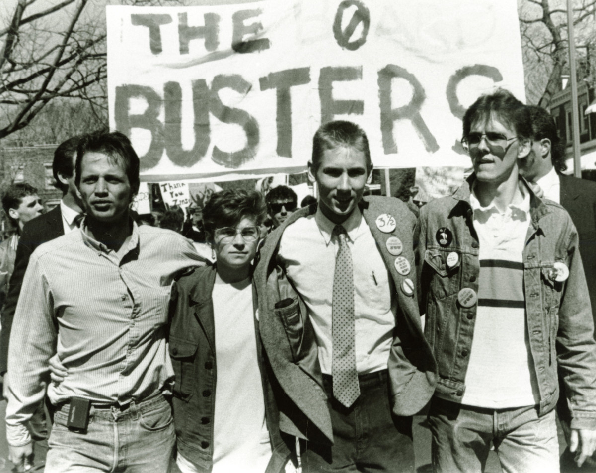 Four student leaders of the Deaf President Now protest—Tim Raurus, Bridgetta Bourne-Firl, Greg Hlibok, and Jerry Covell—leading protesters at Gallaudet University in March of 1988.
