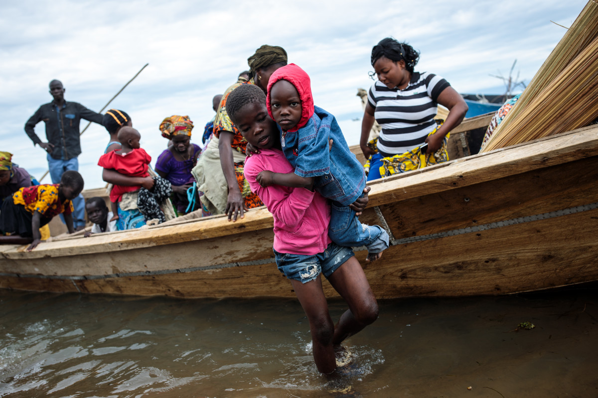 Refugees from Tchomia in the Democratic Republic of Congo arrive on boat at the Nsonga landing site on April 9th, 2018, in Nsonga, Uganda. The perilous journey across Lake Albert from DRC to Uganda can take up to two days and has seen a number of Congolese die during the crossing. According to the United Nations High Commissioner for Refugees, almost 70,000 people have arrived in Uganda from the Democratic Republic of Congo since the beginning of 2018 as they escape violence in the Ituri province. The majority of refugees are arriving by boat across Lake Albert, which lies between the two countries.