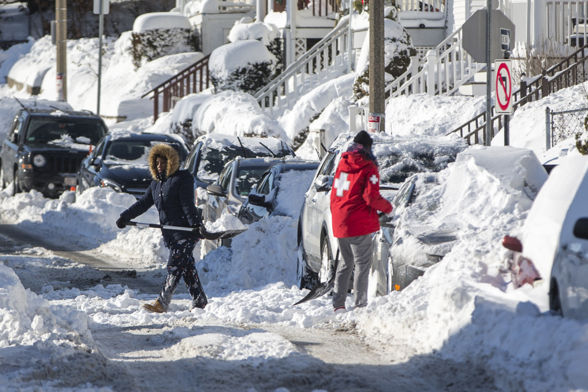 Residents shovel out vehicles the day after a snowstorm, on January 5th, 2018, in Boston, Massachusetts.