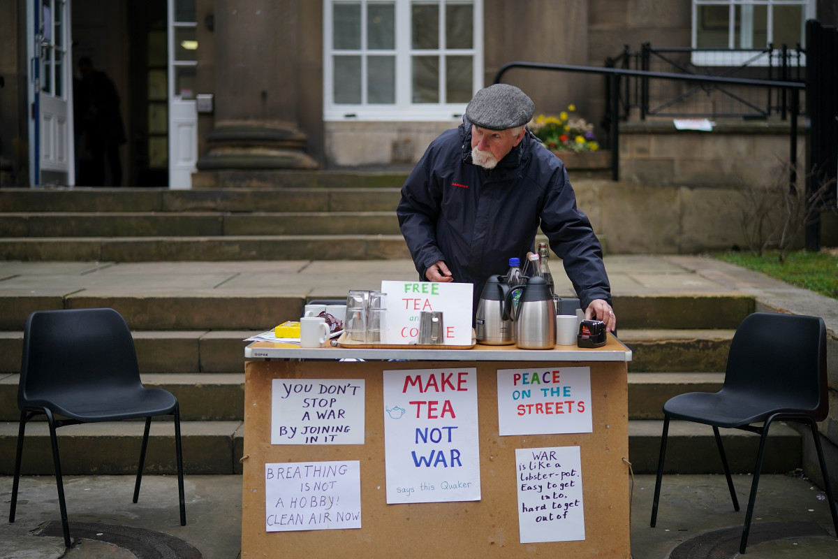 Quaker Alan Pinch makes tea for passersby as he holds a protest against war and military action in Syria on April 12th, 2018, in Manchester, England.