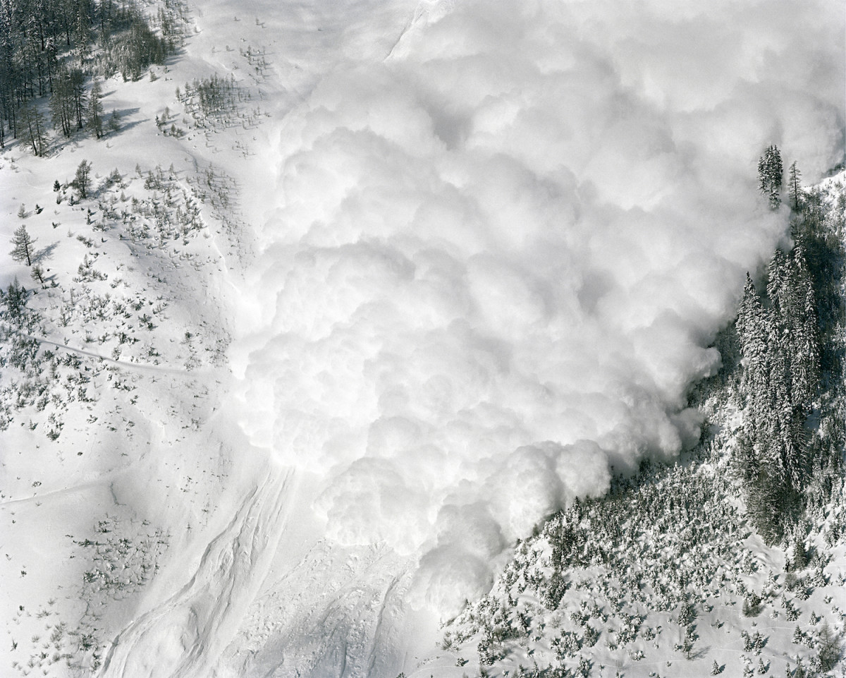 Arbaz, Switzerland: A controlled avalanche, started with dynamite, slides down a mountain in the Swiss canton of Valais.