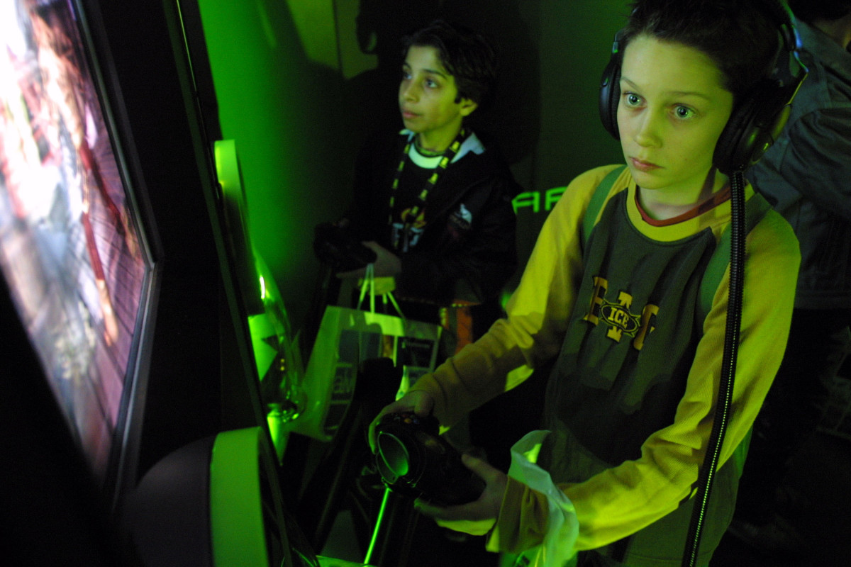 Visitors play with Microsoft's Xbox gaming system at the CeBIT technology trade fair March 12th, 2003, in Hanover, Germany.