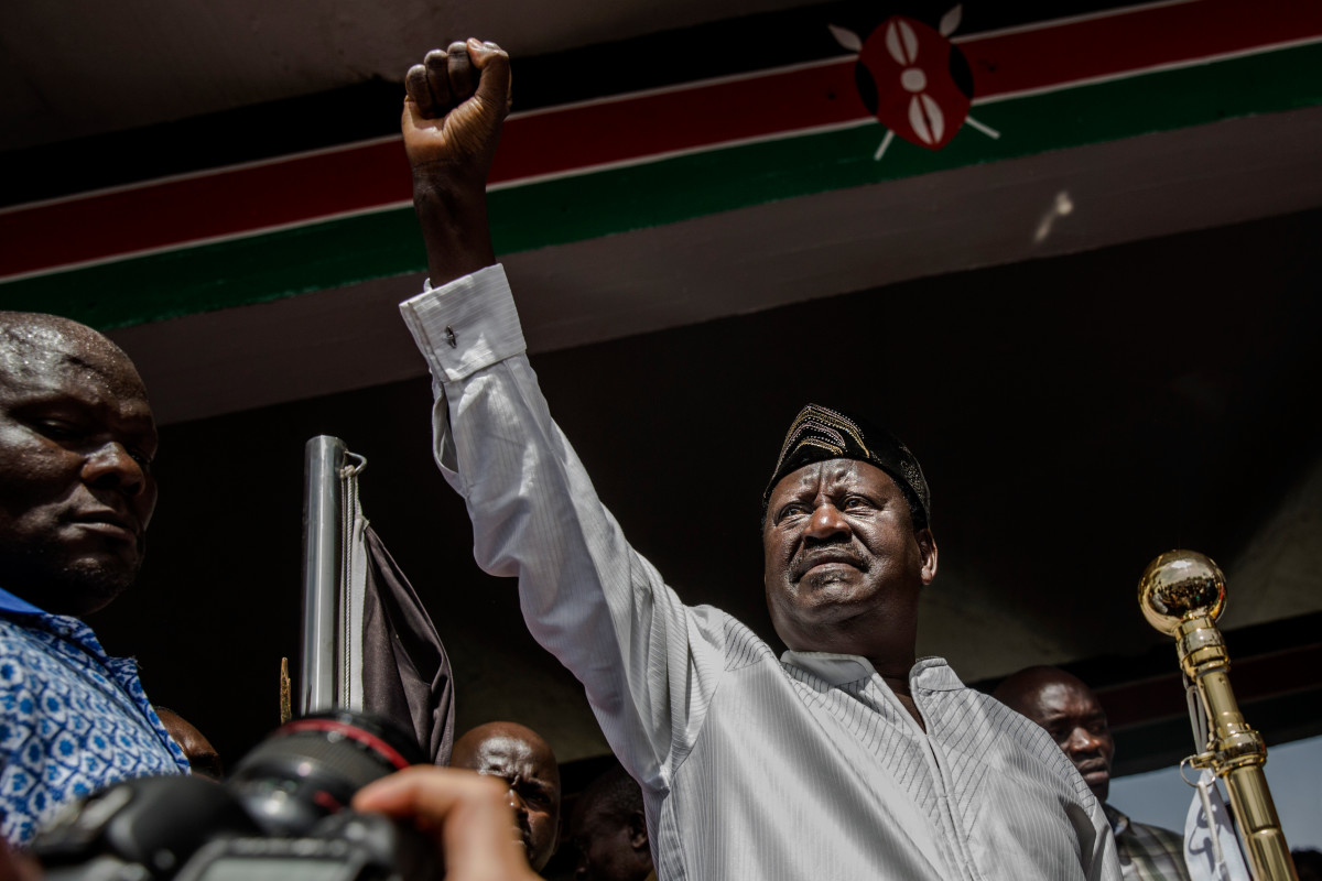 "Kenyan opposition National Super Alliance coalition leader Raila Odinga gestures before swearing himself in as the ""people's president"" on January 30th, 2018, in Nairobi. Odinga had himself sworn in as an alternative president in front of thousands of supporters three months after an election he claims was stolen from him."