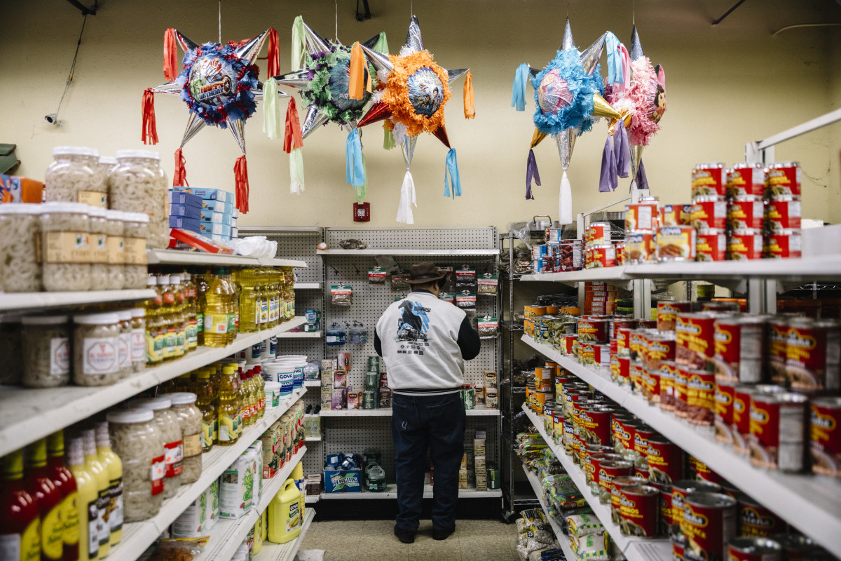 Piñatas hang from the ceiling in Tienda El Ranchito, a Latin grocery store in Fairmont City, Illinois.