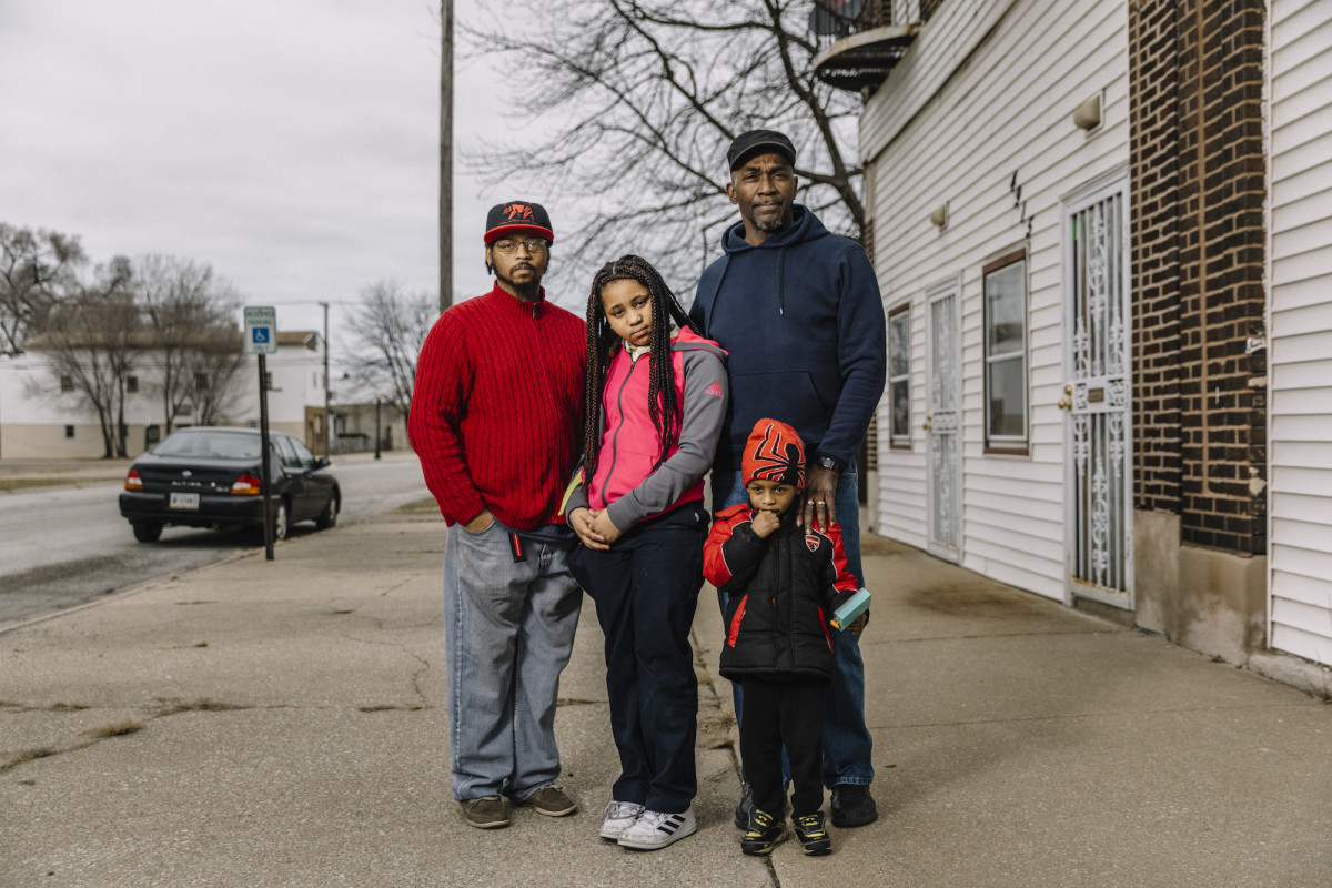 Devin Crymes (61) stands with his son James Boyd (36) and grandchildren Jania Boyd (10) and James Lee Boyd (four) in front of his house on Alexander Avenue, located in Zone 2 of the U.S.S. Lead Superfund site in East Chicago.