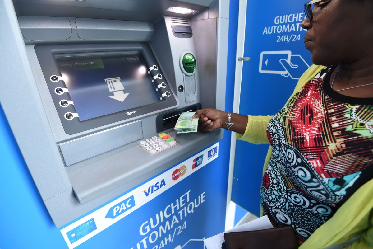 A woman uses an Ecobank Ivory Coast cash dispenser on September 18th, 2017.