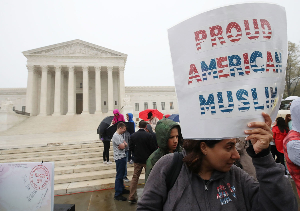 People gather to protest President Donald Trump's travel ban in front of the U.S. Supreme Court, on April 25th, 2018, in Washington, D.C.