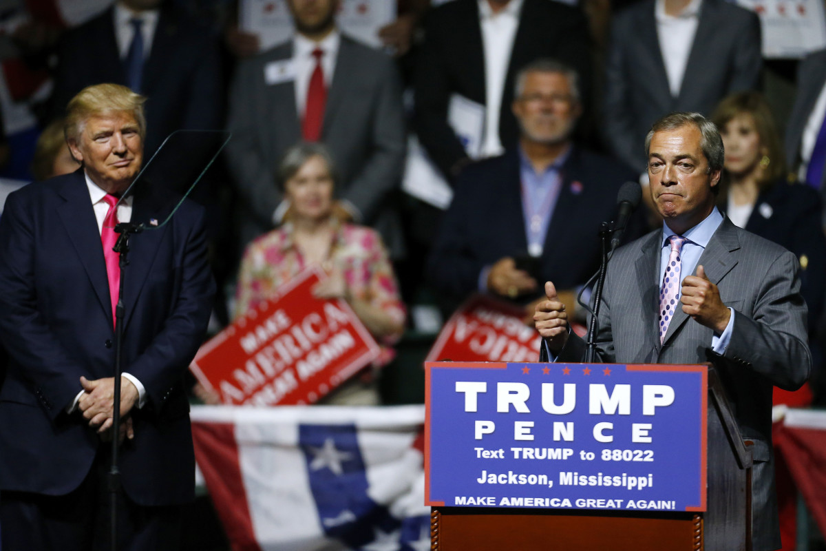 Then-presidential candidate Donald Trump listens to United Kingdom Independence Party leader Nigel Farage during a campaign rally at the Mississippi Coliseum in Jackson, Mississippi, on August 24th, 2016.