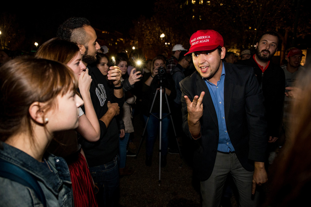 Donald Trump and Hillary Clinton supporters argue in front of the White House while waiting for election results on November 9th, 2016, in Washington, D.C.