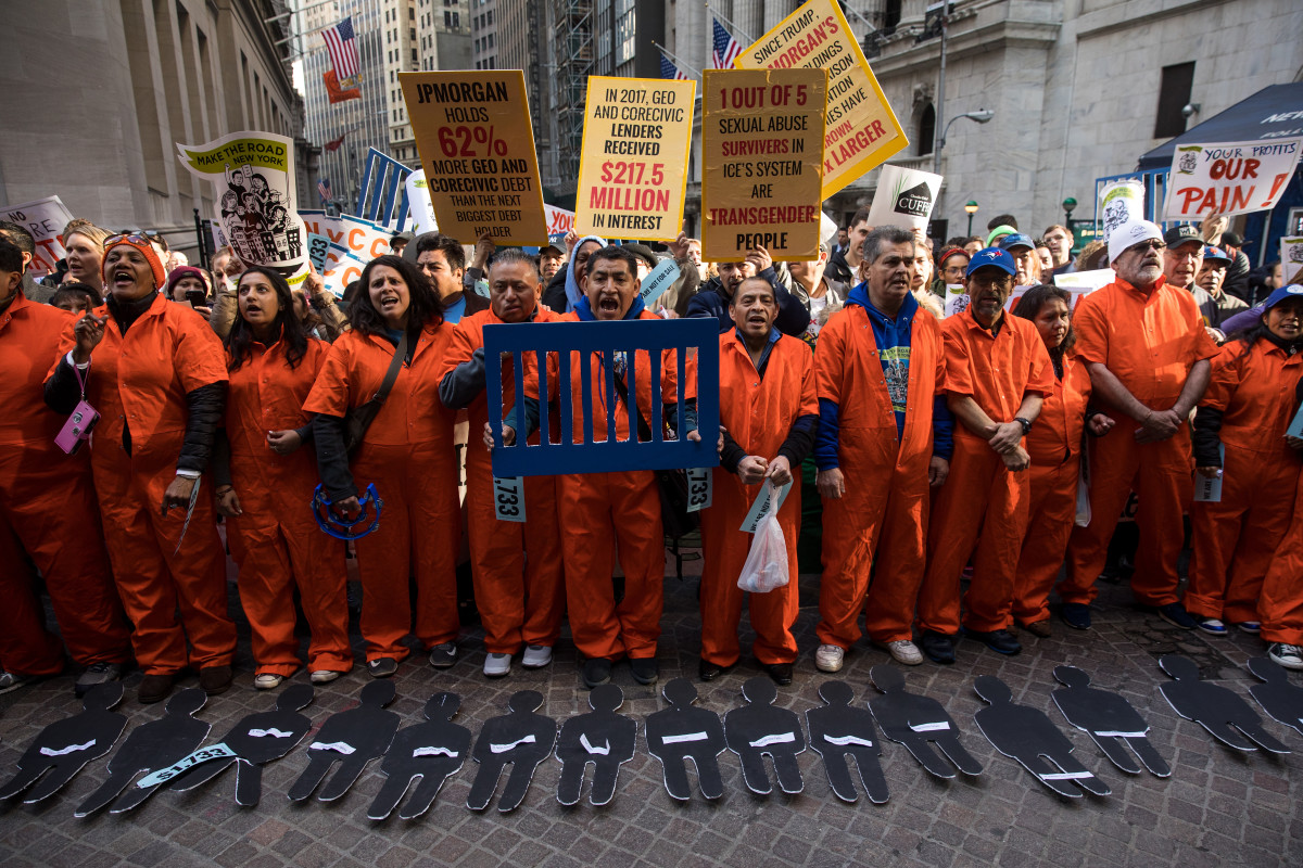 Activists rally against financial institutions' support of private prisons and immigrant detention centers, as part of a May Day protest near Wall Street on May 1st, 2018, in New York City.