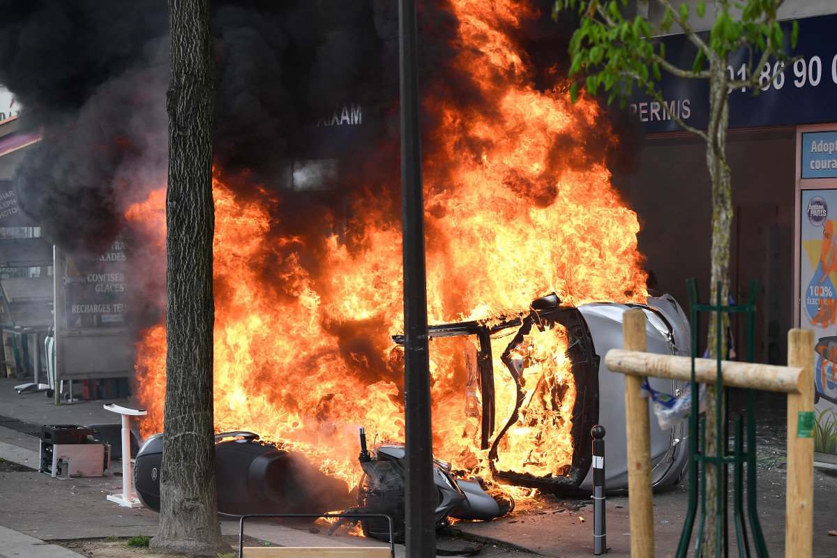 Vehicles are burned as thousands of people take to the streets during the May Day demonstrations on May 1st, 2018, in Paris, France.