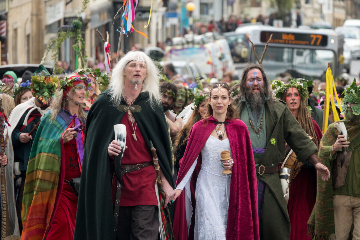 "The May Day ""King"" and ""Queen"" lead the Greenmen of Glastonbury carrying this year's Maypole through the center of Glastonbury, to a ceremony at Bushy Combe below Glastonbury Tor as part of the town's Beltane May Day celebrations on May 1st, 2018, in Somerset, England. Although more synonymous with International Workers' Day, or Labor Day, May Day or Beltane is celebrated by druids and pagans as the beginning of summer and the chance to celebrate the coming of the season of warmth and light."