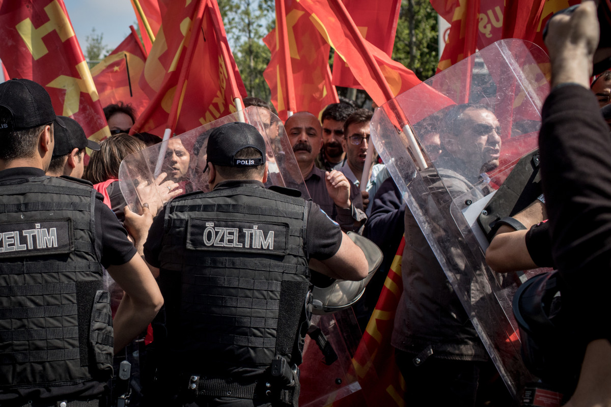 Protesters clash with police on a street in the Besiktas neighborhood during a May Day demonstration on May 1st, 2018, in Istanbul, Turkey. People demonstrate around the world on May Day to fight for workers' rights.