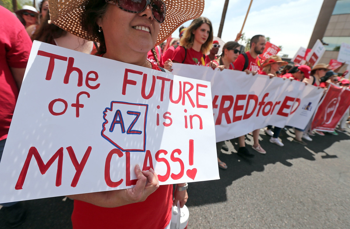 Arizona teachers march toward the State Capitol in Phoenix, Arizona, on April 26th, 2018.