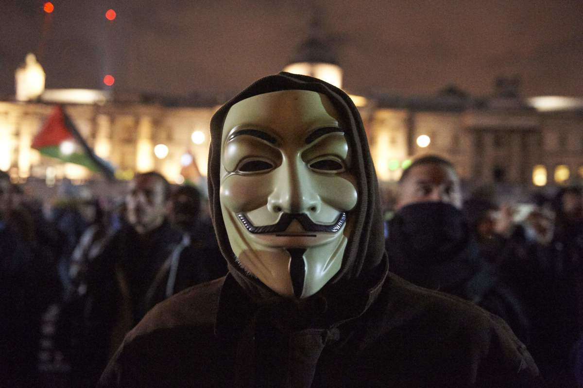 A man pictured here in London, England, wears the iconography of the Anonymous movement, on November 5th, 2017.